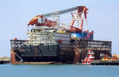 The large Derrick Barge, Tetra Hedron, in dry dock