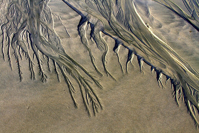 Tidal runoff - pattern created in the sand by the wash of tide waves. Long Beach - Tofino, BC