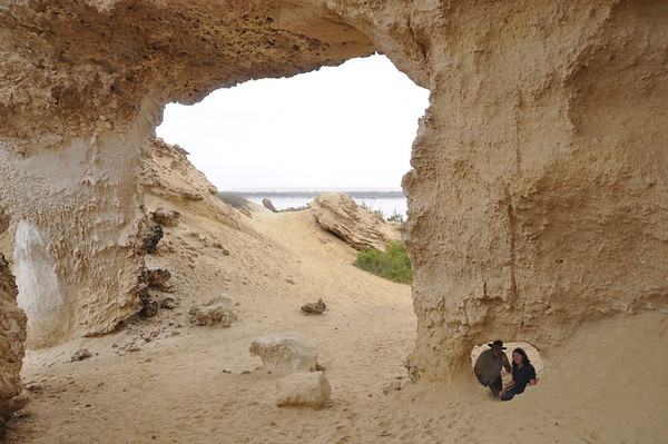 One of the sandstone arches that give Lake Arco its name.  John and Beth, the authors of this photo gallery, appear in a heart-shaped window.
