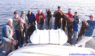 Our gang, holding up our Ling Cod......