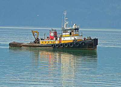An Alaskan Construction tug boat on the Alaskan Marine Highway, outside Wrangell, Alaska.