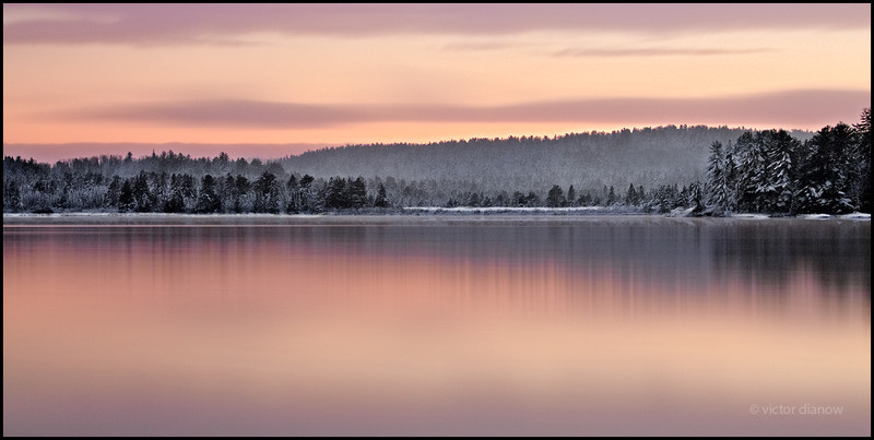 <h3>Lake of Two Rivers. Algonquin Ont.</h3> <h5>Canon40D, Canon70-200 at 70mm, Lee 0.9 hard grad,<br> 300s at f/4.0</h5><br> During the day I had already expected the evening to be a complete loss.  It was an unruly November day, with weather changes occuring every 15 minutes, from bright sun to heavy snow.  Shortly after sunset I was on my way home when I decided to stop at this location, which is right off the highway. The view before me grabbed my attention so I decided to set up my tripod/camera and even managaed to drop one of my lenses in the snow.  When I looked through the viewfinder, I realized it was so dark that I couldn't see a thing.  Despite all this, I persisted because the view on the horizon caught my eye.  I had to act quick as the scene before me was slowly disappearing, so I made my best educated guess and set exposure time to 300s.<br> I took one shot.