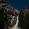 "The full moon creates a ""moonbow"" in the mist of Lower Yosemite Falls -- Yosemite National Park"