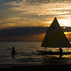 Coming home -- winds die towards sunset and a father pulls his son home