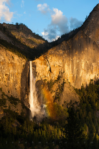 Late afternoon light creates a rainbow on Bridalveil Falls, in Yosemite National Park