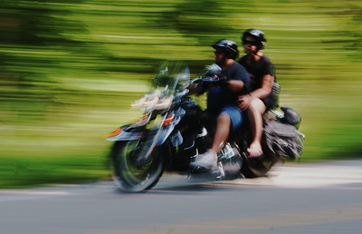 "Motorcyclists cruising through the ""tail of the dragon"" (NC 28 and TN 129) in the Great Smoky Mountains of North Carolina and Tennessee."
