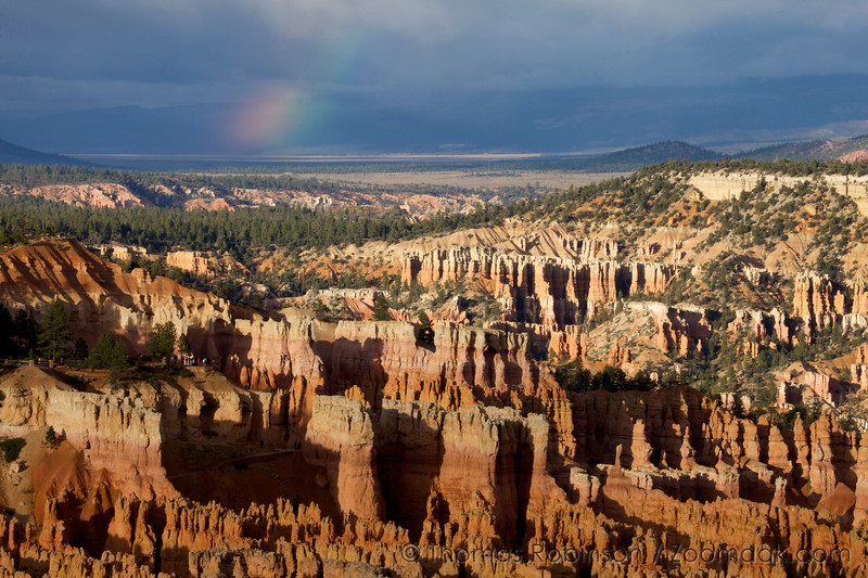 A rainbow shimmers above Bryce Canyon at Sunset Point.