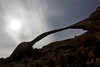 Landscape Arch stands silhouetted against the sky. Landscape Arch is the longest arch in Arches National Park in Utah with a width of 290ft (88.4m).