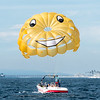 """Be Happy"" as you parasail."