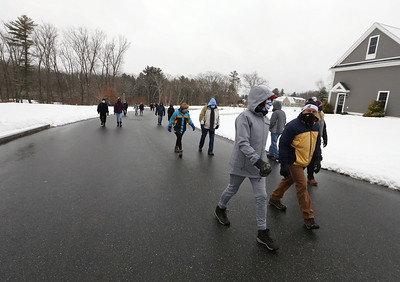 Dracut Land Trust's annual Town of Dracut birthday hike, on Tranquility Trail from Broadway Road. The group walks up Brentwood Drive to get from one part of the trail to another. (SUN/Julia Malakie)