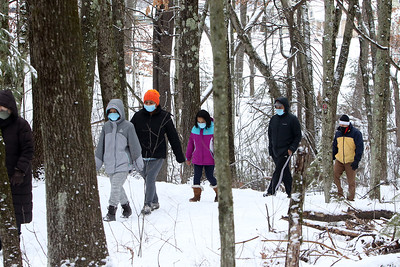 Dracut Land Trust's annual Town of Dracut birthday hike, on Tranquility Trail from Broadway Road.  Pawan Shrestha, second from right, his wife Maushami in orange hat, and daughters Ritu, 10, left, and Isha, 8, of Waltham. Pawan Shrestha said they love to drive to walks to get to know other towns, and heard about this one on Facebook.(SUN/Julia Malakie)