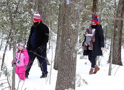 Dracut Land Trust's annual Town of Dracut birthday hike, on Tranquility Trail from Broadway Road. Alex and Kaci Brown of Nashua, with daughter Olivia, 3, and son Conor, 5 months. (SUN/Julia Malakie)