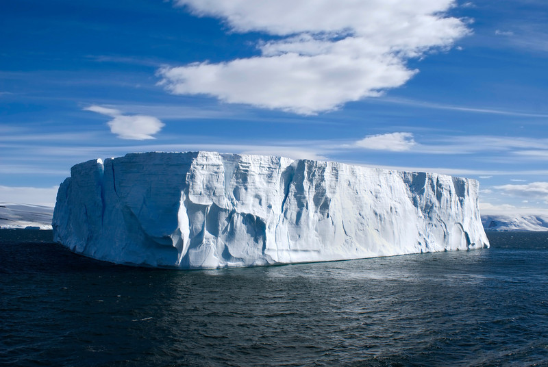 Large tableture iceberg with clear blue sky taken at Antarctica.