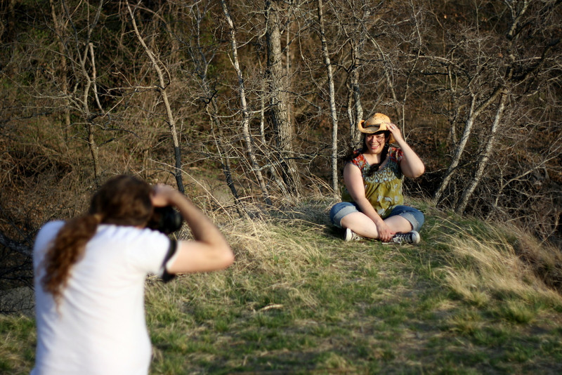 Kent was snapping pictures of his wife as she sat on the edge of a cliff, while the wind was doing its level best to steal Judy's hat.