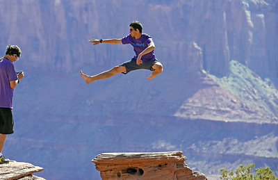 This young man from Germany was doing some jumps on a pedestal rock at the edge of Dead Horse Point for his brother to catch with his camera and while the brother was reviewing his shots I caught the guys attention and he did a couple for me. After I showed him mine he was pretty excited since his brother was using a cell phone. I've sent it to him and he was pleased.