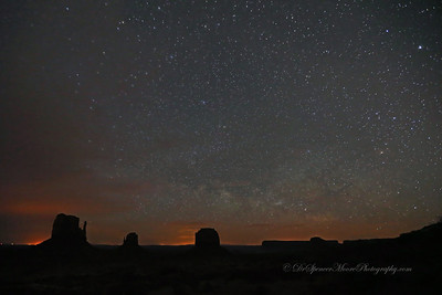 In spite of a few thin clouds, I got an fairly good shot of Monument Valley in the middle of the night with all the stars in the sky and some lights from some far away towns lighting up the night time horizon. Those lights were not visible to us until I shot the time exposures. It was an interesting sight.