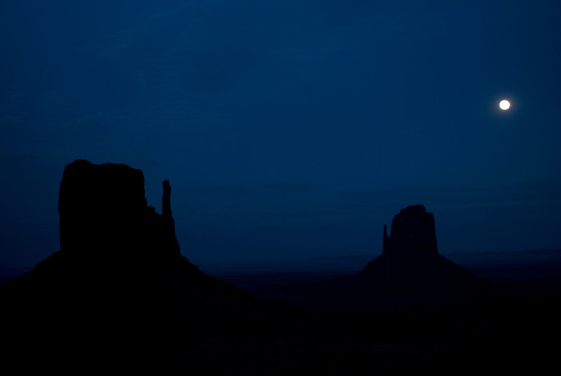 Full moon over Monument Valley.