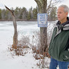 Ashburnham resident Robert Fichtel and neighbors want to the town to change the new rule banning rowboats from the Upper Naukeag Lake in town. A sign telling people that the lake is the towns water supply is right behind Fichtel as he talks about the problem at the boat launch he has been using since he was a boy. SENTINEL & ENTERPRISE/JOHN LOVE