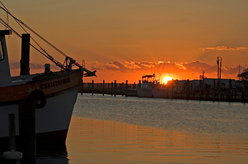 Sunset over the marina.  Fishing boat Christopher in foreground.