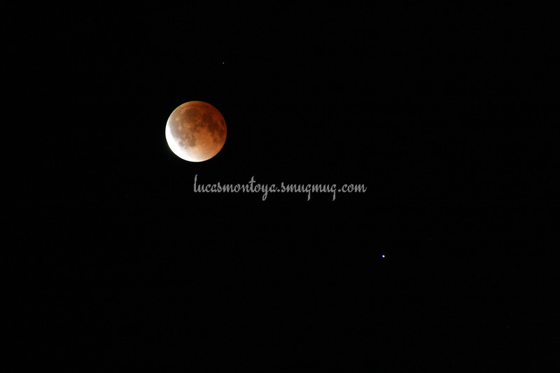 2014-04-15 Lunar Eclipse; beginning to exit out of total eclipse. Spica is star on lower right of moon.