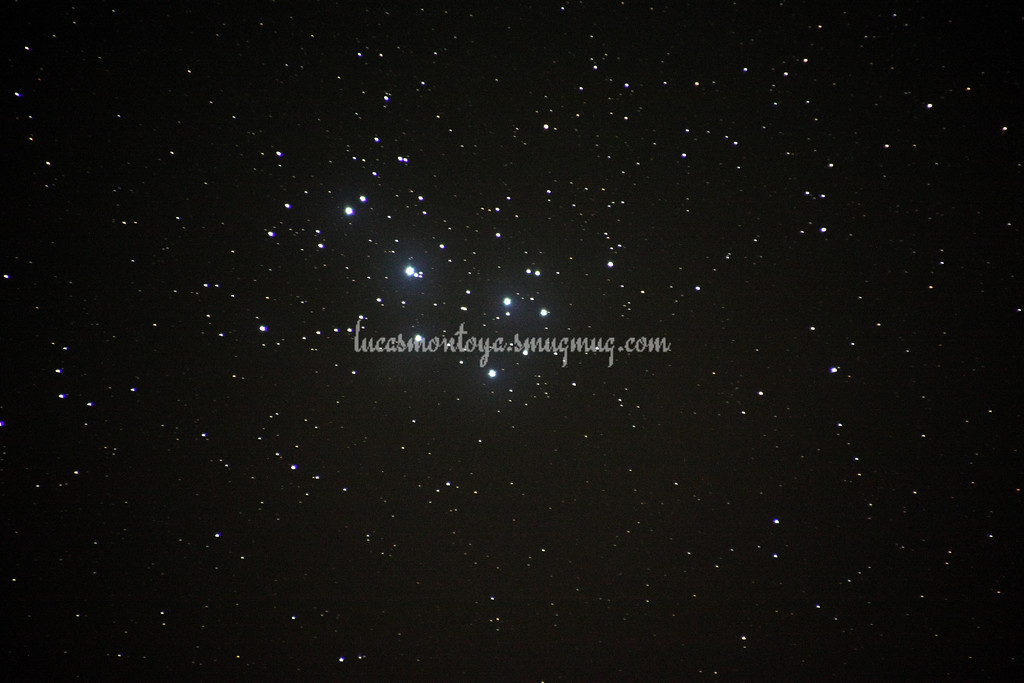 Pleiades (M45), also known as the Seven Sisters; able to see hint of interstellar dust cloud illuminated as blue by the stars but unrelated to the stars themselves; some high cloud distortion. 15 Feb 2015 — in Estes Park, Colorado.
