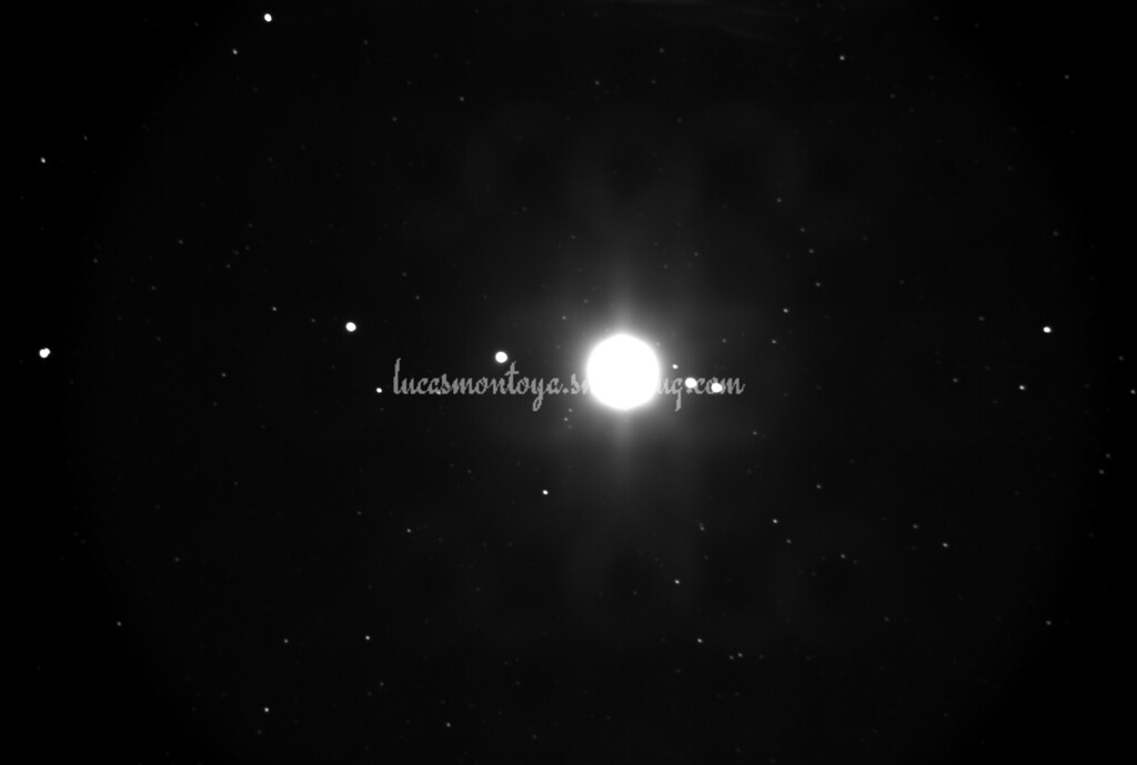Jupiter, 2008-08-02; Jupiter overexposed to show moons; B&W Photo - Colorado Springs, Colorado