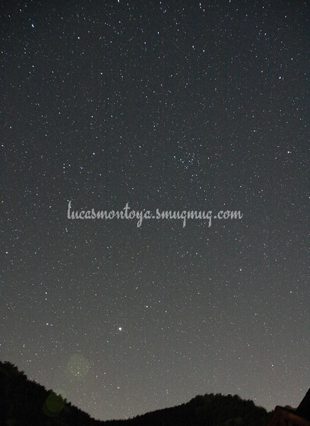 Arcturus rising in the east at about midnight; Virgo galaxy cluster center right — in Estes Park, Colorado.