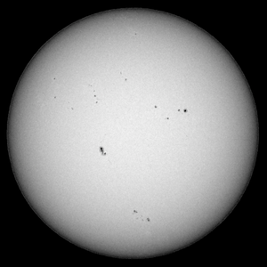 The Sun as seen from Sydney on 2013-05-17.  The sun spot group towards the bottom of the photo is Active Region 1748, responsible for 4 X-class solar flares in the space of less than 48 hours (see http://apod.nasa.gov/apod/ap130516.html).  Sony A100 DSLR with Sony 500/8 AF Reflex, 1/500 s, f/8, ISO 200.