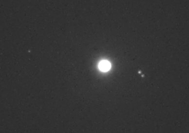 Left to right: Callisto, Jupiter, Ganymede and Europa
