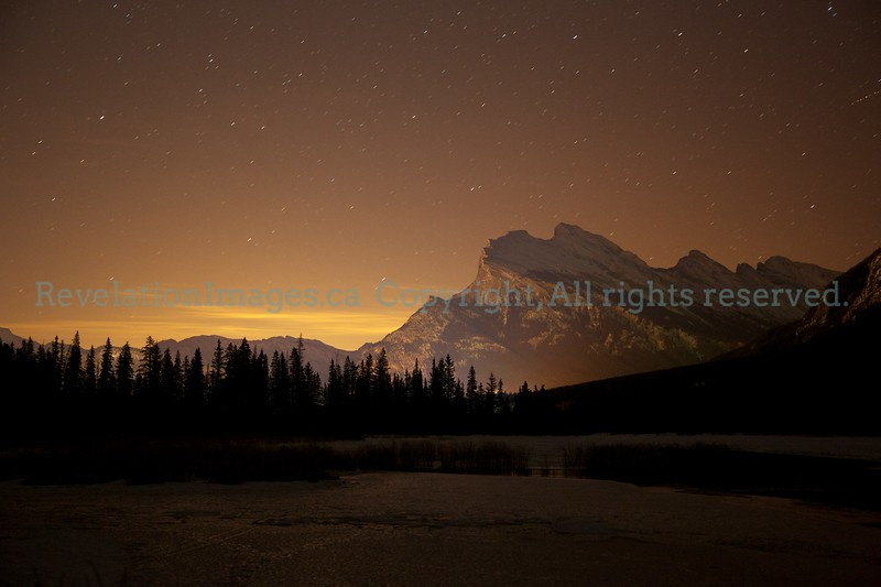 Mount Rundle at night with city glow