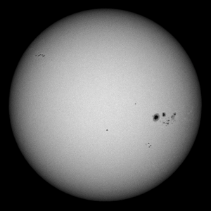 The Sun as seen from Sydney on 2014-01-05.  The large sunspot group to the right is Active Region 11944.  Sony A100 DSLR with Sony 500/8 AF Reflex, 1/1000 s, f/8, ISO 100.
