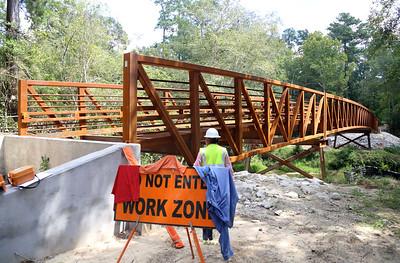 Right beside us, surveyors check a new bridge that's under construction.