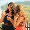 Candid moment, ladies appreciating a selfie