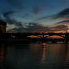 Sunset at congress avenue bridge with a sight of bats at flight