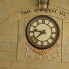 """Time Conquers All"" clock in a Sydney establishment."