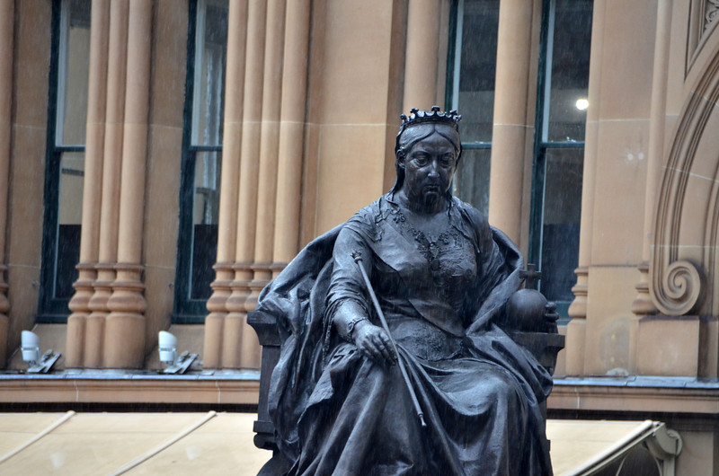 """Not Amused.""  Queen Victoria remains unmoved by a cold winter rain.  Presumably she kept a stiff upper lip through it all.   (Outside the shopping center named in her honor, near the Park Regis Hotel where we stayed in Sydney.)"