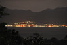 Across the bay twinkle the lights of Alotau, the capital of Milne Bay Province, Papua New Guinea.