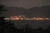Across the bay twinkle the lights of Alotau, the capital of Milne Bay Province, Papua New Guinea.