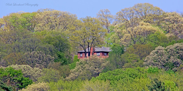 Mansion with nice Springtime foliage surrounding it in Cold Spring Harbor.