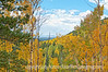 As autumn view in Colorado of distant mountains and colorful aspen; best viewed in the largest sizes