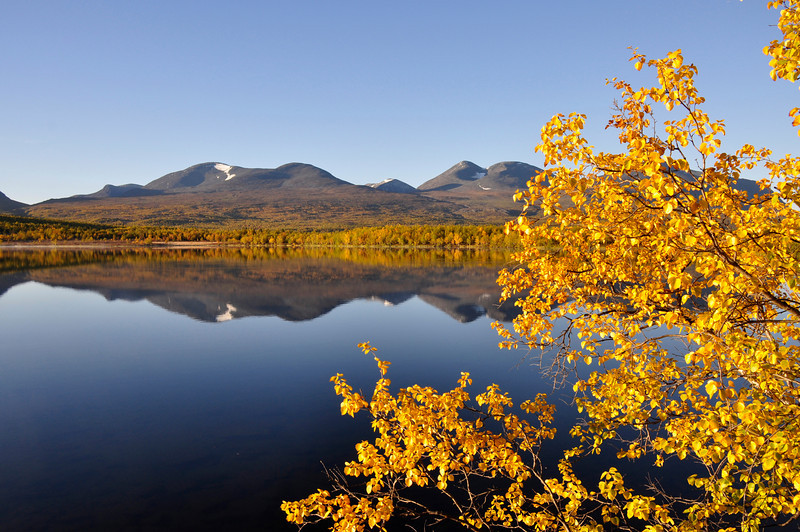 Scenic lake in autumn surrounded by colorful trees