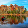 Autumn Reflections in a Canoe