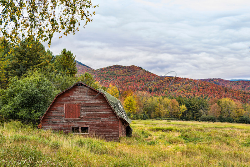 The old red barn in Keene NY is a favorite stop for leaf peepers traveling from all over.  This barn can be found at the intersection of Rte 73 & Rte 9 in Keene.