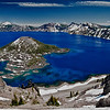 Crater Lake and Wizard Island, looking east toward Mount Scott on far side.  Crater Lake was created by the cataclysmic eruption of Mount Mazama about 7,700 years ago.