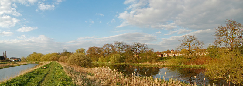 Looking north along the riverside path with the Fishponds on the right