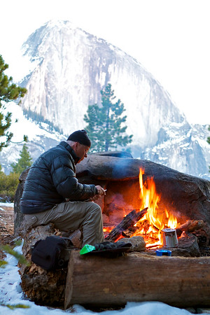 Half Dome in the background with Grandpa carving a spoon from a branch.