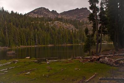 Green meadows surround Summit Lake.