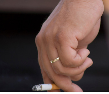 Hubby's rugged hand with of course... a cigarette.