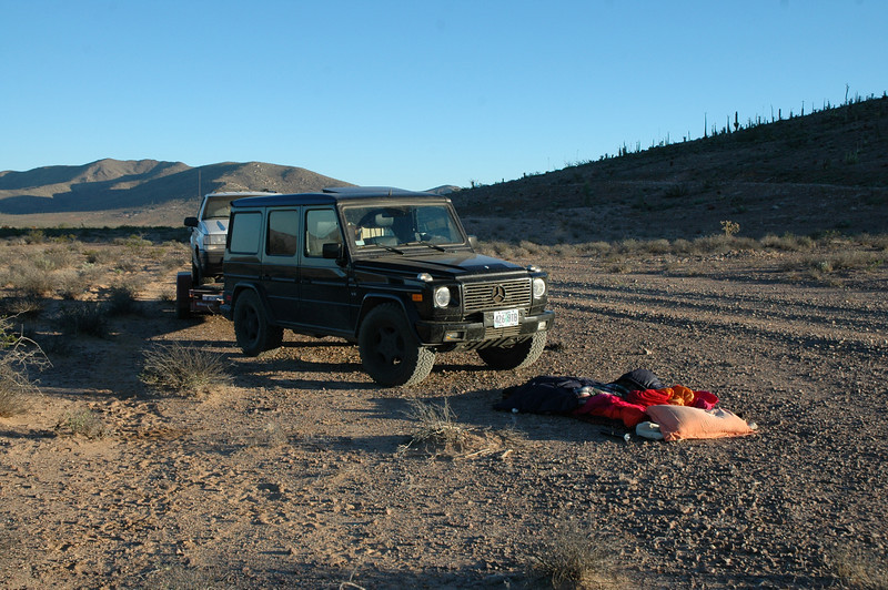 I usually sleep right next to the car on the ground - no tent needed