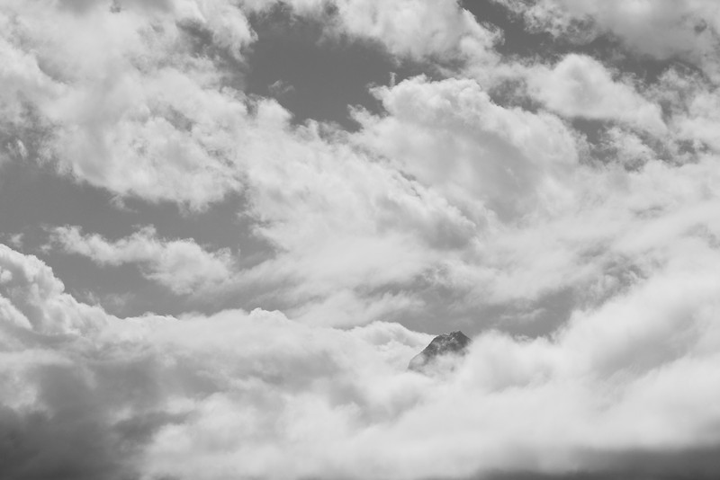 A peak peeking through the clouds.